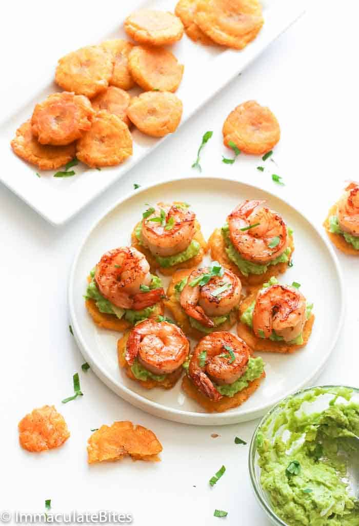 Tostones Topped with Guacamole and Seasoned Shrimp