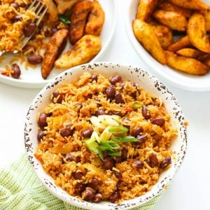 Fried rice with beans served with plantains