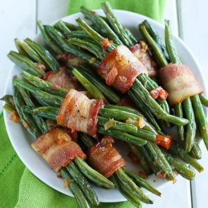 bacon wrapped beans on a plate