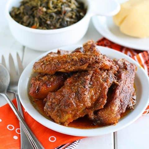 grillafricanchickencamerooncameroonfood cameroonrecipesethnicfoodexoticfoodafricanfoodpaleorecipesafricancuisineafricanfoodyummykatikatipalmoilredoil katikati chicken smothered in spice sauce on thehellip