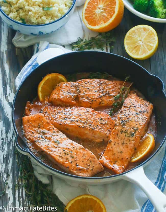 A pan of Orange Honey Glazed Salmon topped with thyme