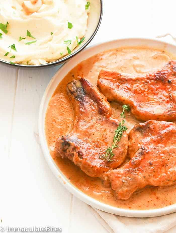 Smothered pork chops immaculate bites this is the kind of recipe that you can order at a restaurant that annoyingly cost a lot without giving you a full satisfaction like is there anyone out ccuart Choice Image