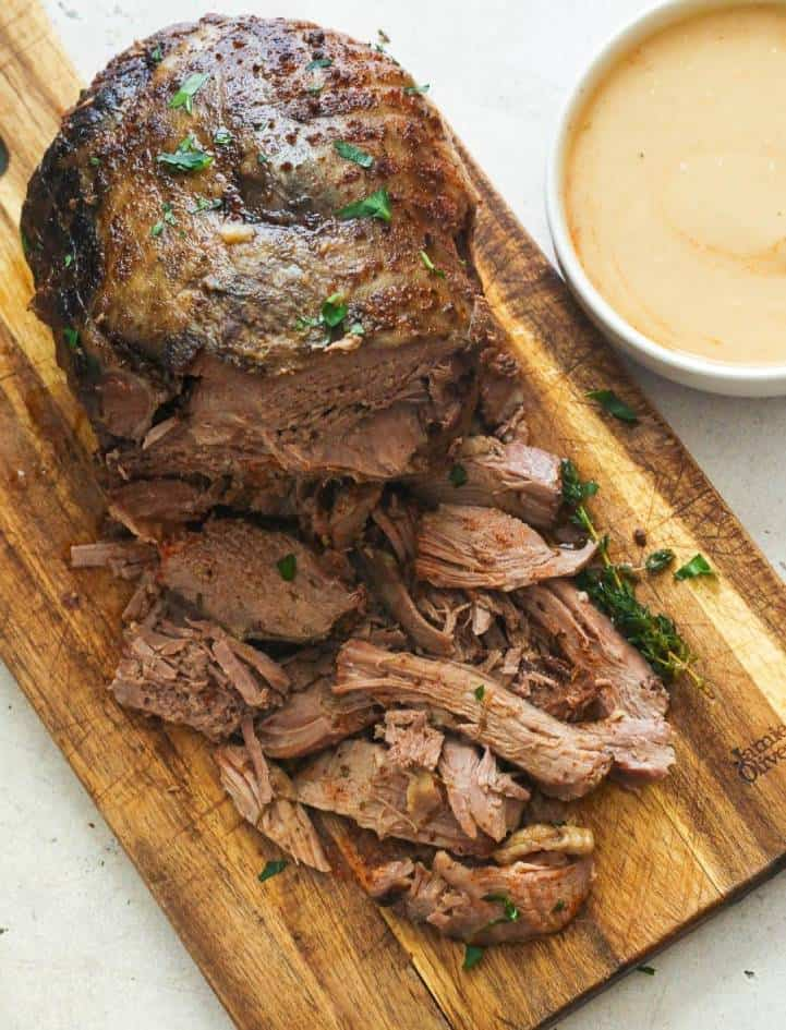 Slow Cooker Lamb Leg on a Chopping Board