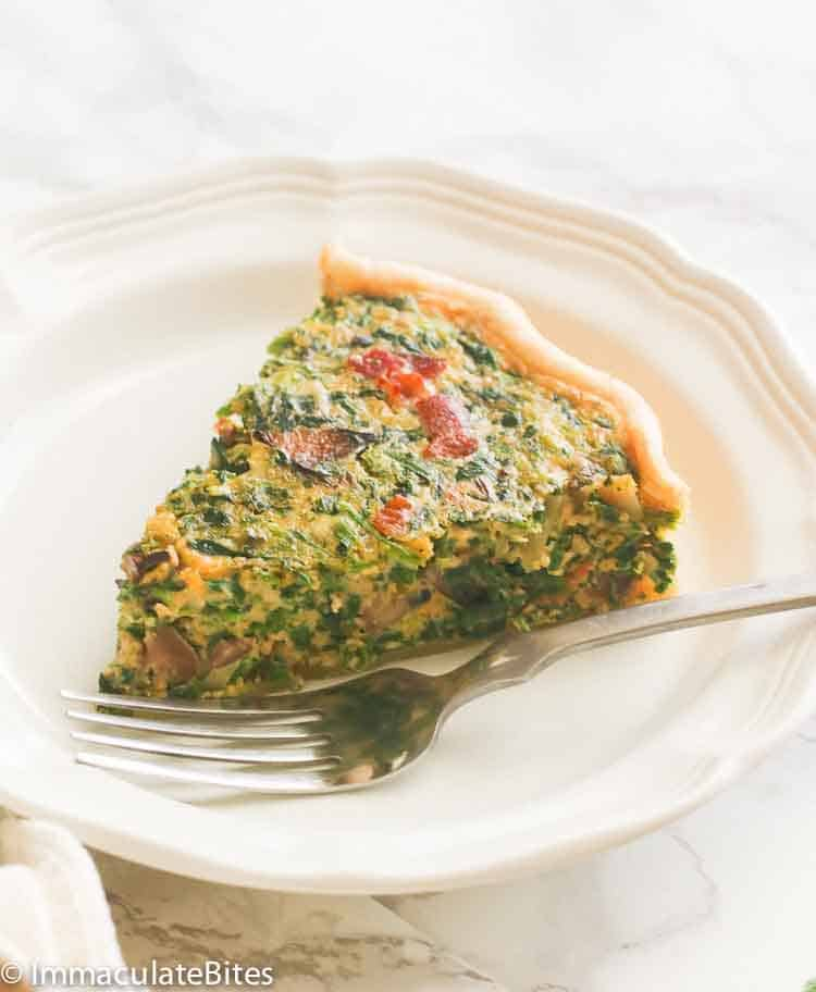 A Slice of Spinach Quiche in a Plate