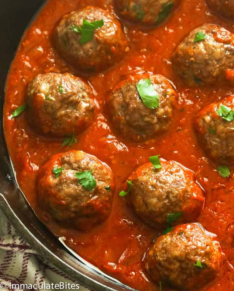 Baked meatballs smothered in tomato-based sauce