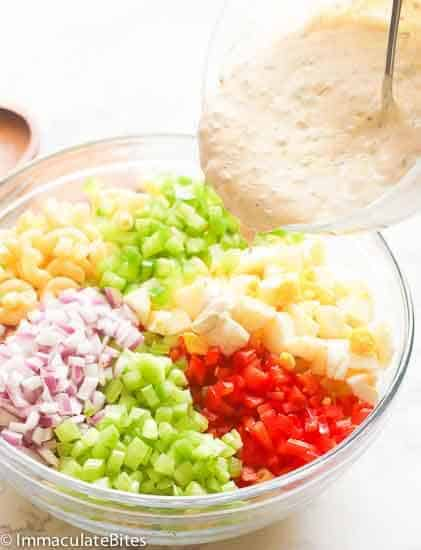 Macaroni Salad Ingredients covered in a mayo-based dressing