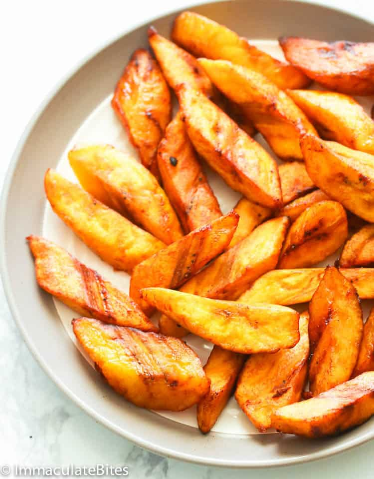 Fried Plantain Cut smaller on white plate