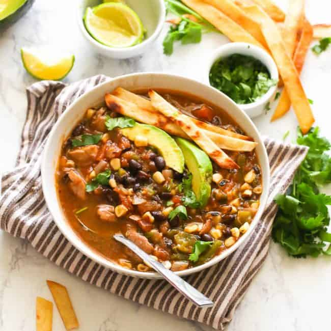 Chicken Tortillas Soup topped with avocado slice