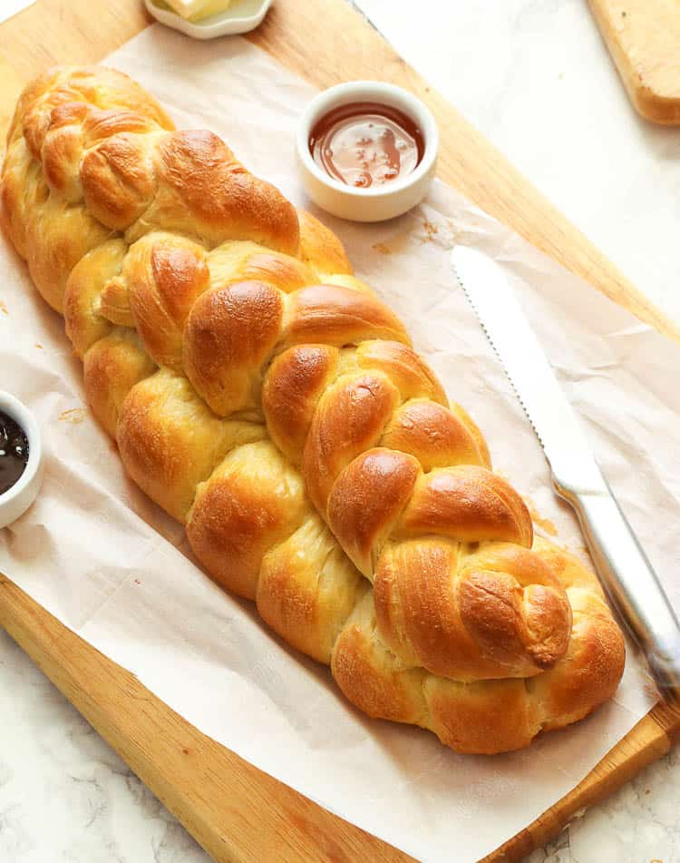 Challah bread beautifully presented with jam
