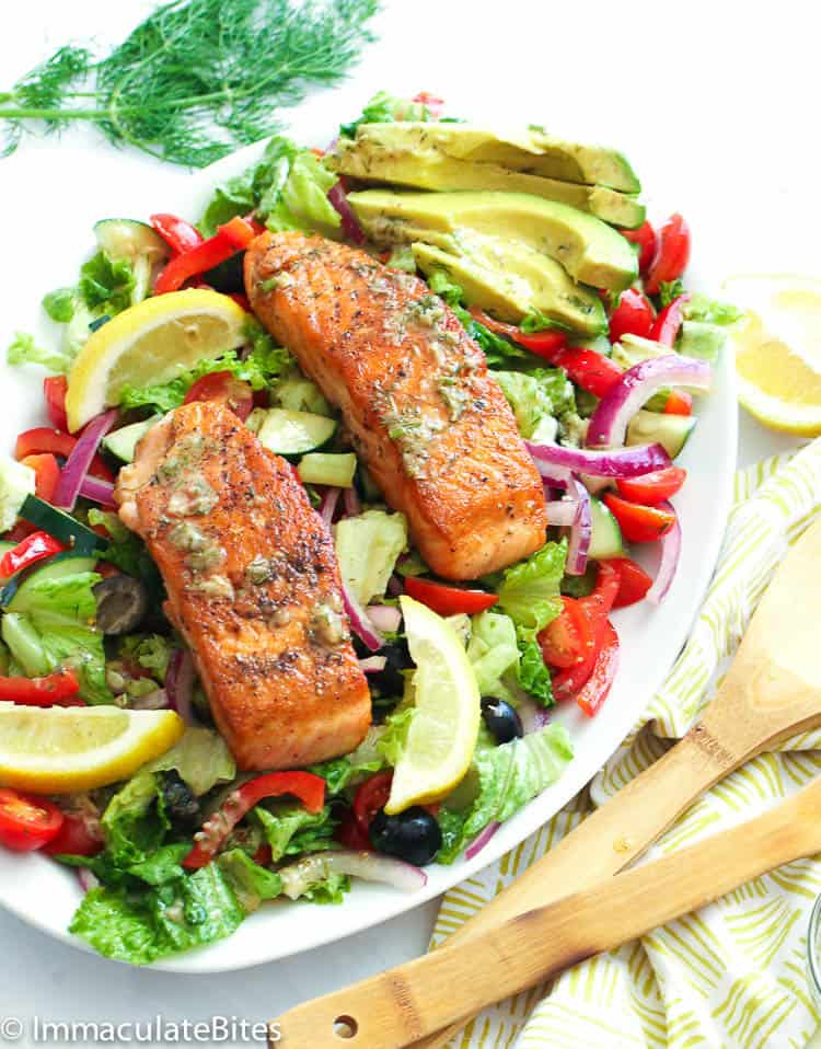 Salmon in a bed of colorful veggies