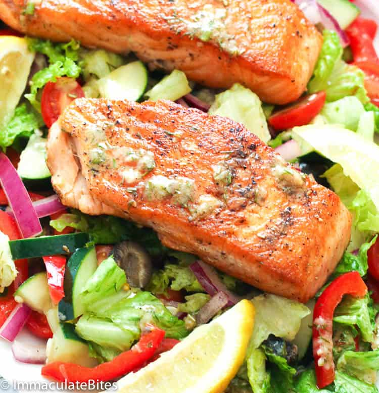 salmon in the center of salad