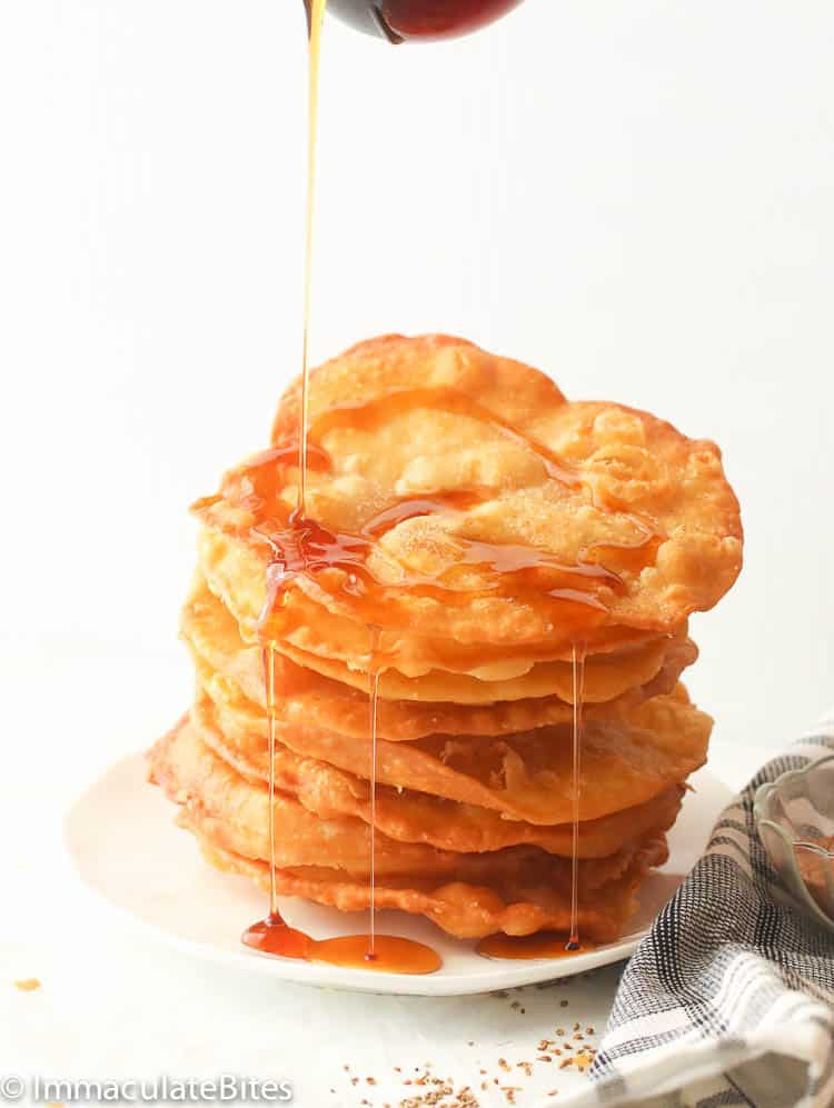 Bunuelos  Recipe drizzled with Piloncillo Syrup