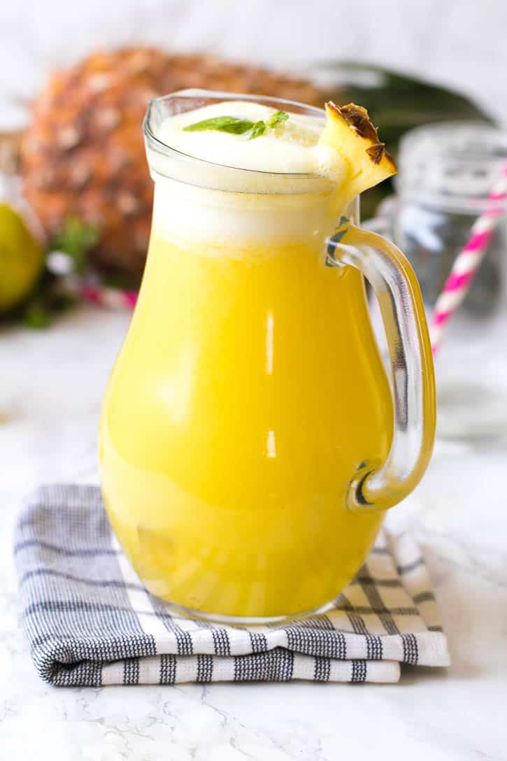 Pineapple juice in a glass pitcher