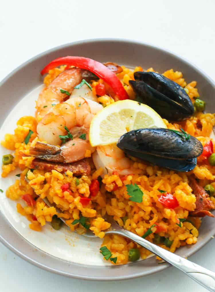 Seafood Paella served with lemon