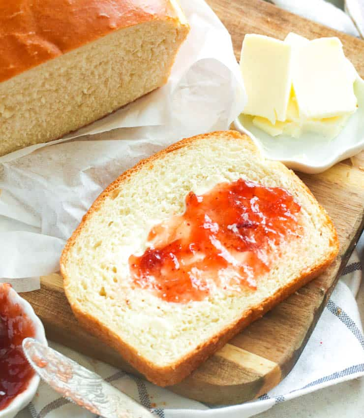 Closeup shot of sliced bread slathered with jam