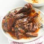 Braised Lamb Shank in a pan