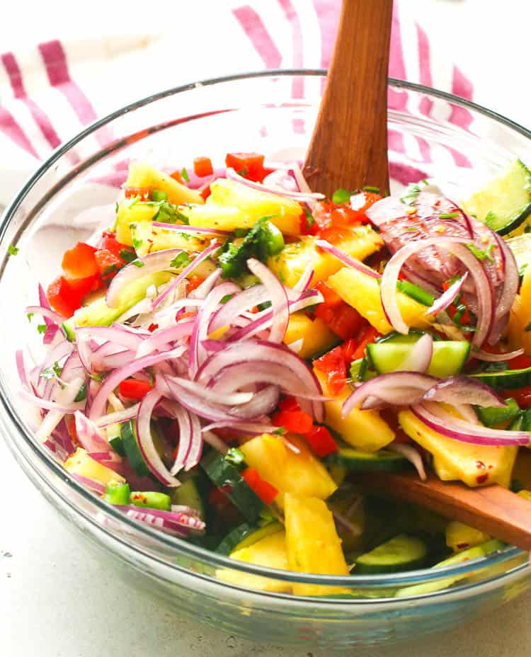 Pineapple Cucumber Salad in a clear bowl