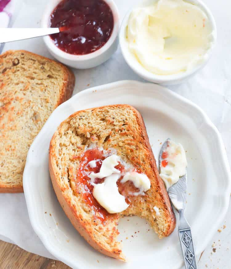 Sliced Whole Wheat Bread Smothered with Jam and Butter