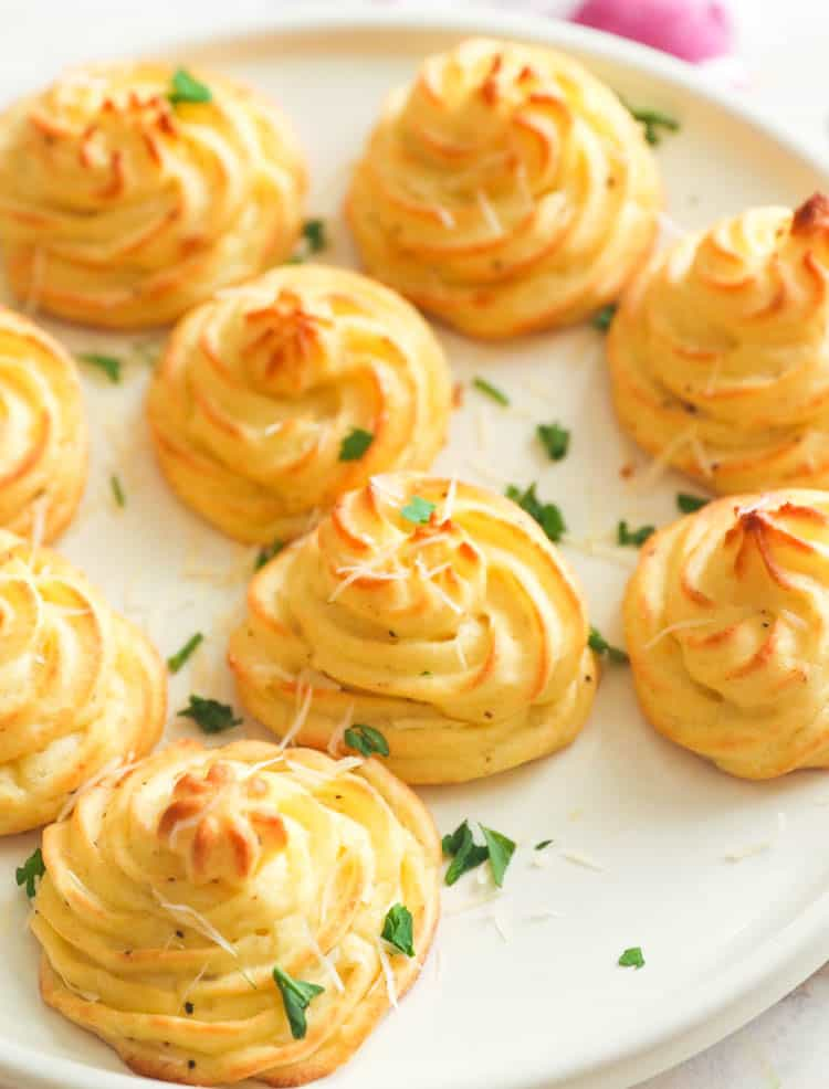 Duchess Potatoes on a white plate for easter