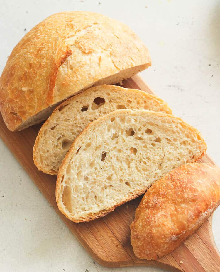 Sliced No Knead Bread on a Chopping Board