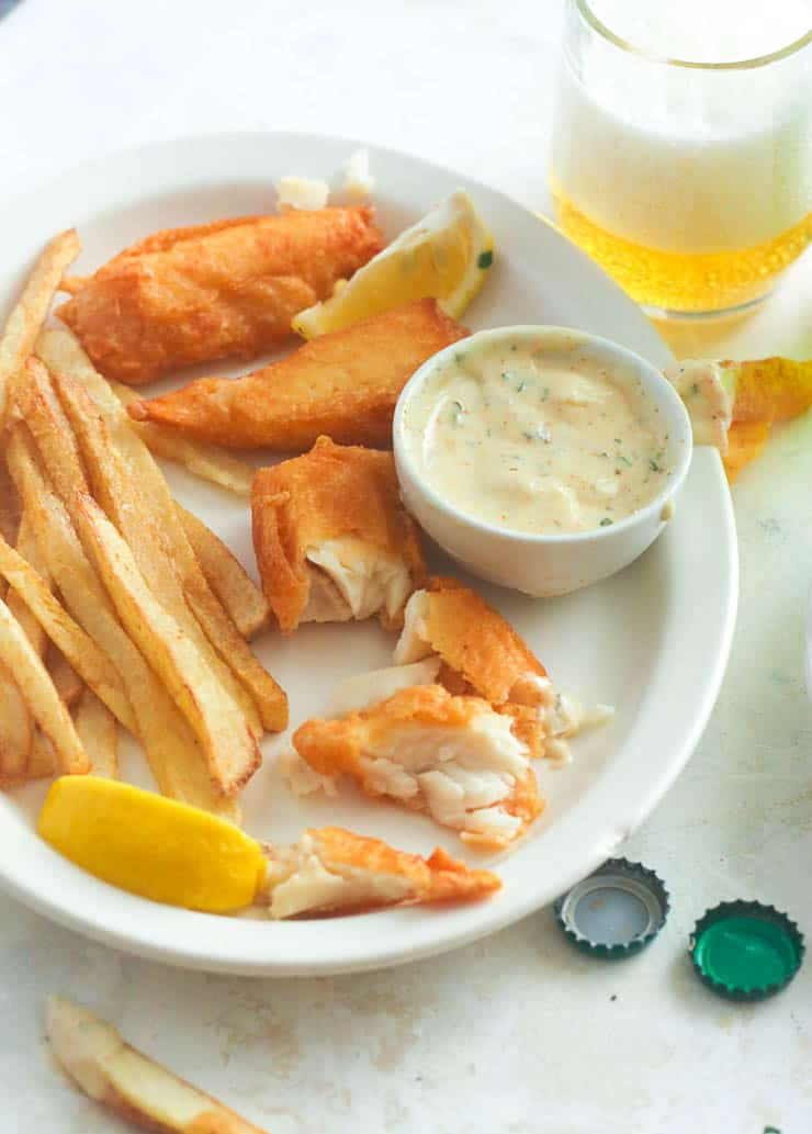 Flaky Fish and Crispy Chips in White Plate