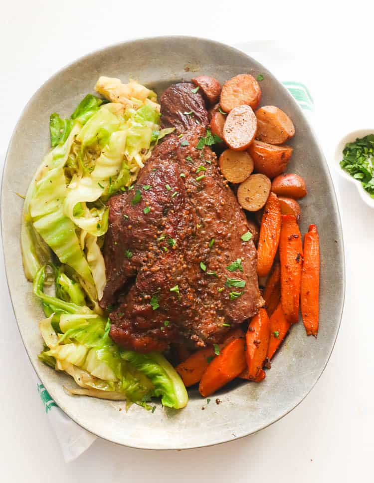 Cornbed Beef and Cabbge with Potatoes and Carrots in a Plate