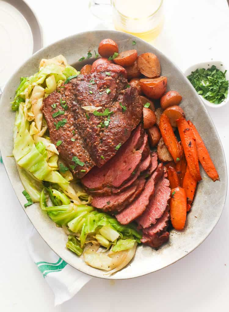 A Platter pf Sliced Corned Beef and Cabbage with Carrots and Potatoes