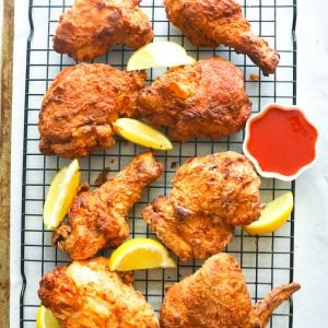 Air Fryer Southern Fried Chicken in a cooling rack with lemon wedges