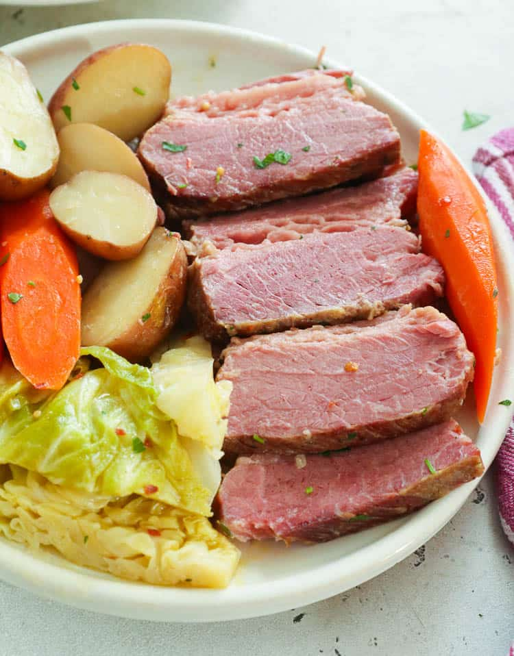 Slices of Corned Beef with Potatoes, Carrots, and Cabbage