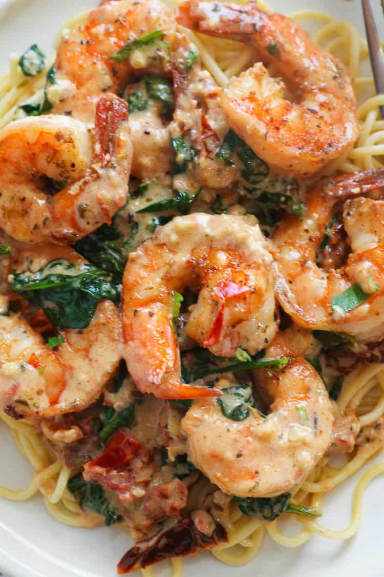 Tuscan Shrimp Served Over Cooked Pasta
