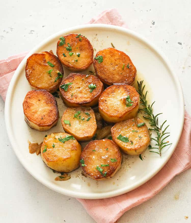 fondant potatoes on a white plate
