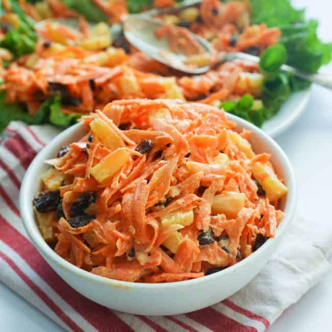 Carrot Raisin Salad in a White Bowl