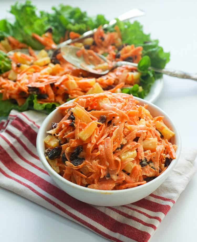 Carrot Raisin Salad in a White Bowl