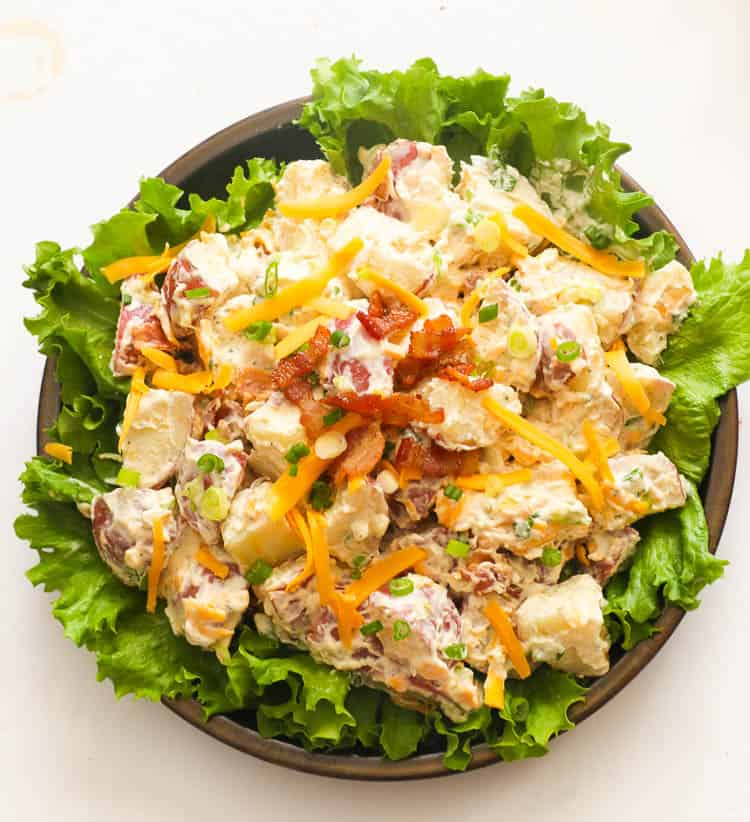 ranch potato salad on a bowl with lettuce