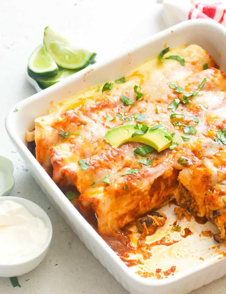 chicken enchiladas on a white baking dish