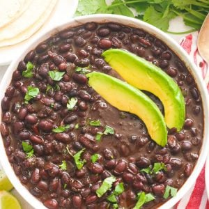 cooked black beans with slices of avocado