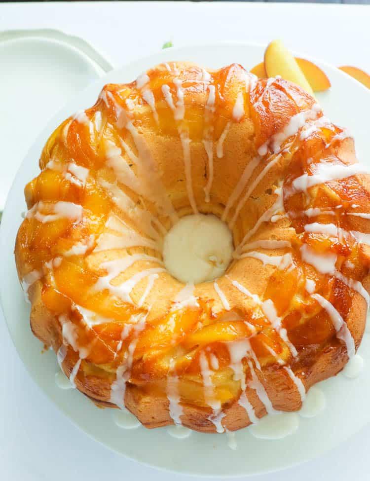 A whole peach cake with vanilla drizzle