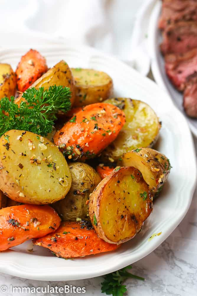 A plate of Roasted Potatoes and Carrots