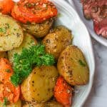 Roasted Potatoes and Carrots topped with fresh pasley