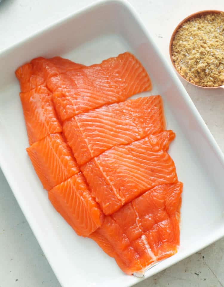 sliced Salmon on a dish with brine mix
