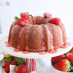 Strawberry Pound Cake with Strawberry Glaze on a Cake Stand