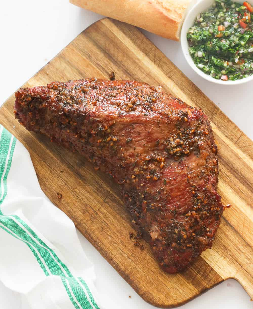 Whole marinated smoked meat on a chopping board