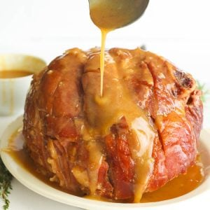 A Slow Cooker Whole Ham glazed with Honey mixture