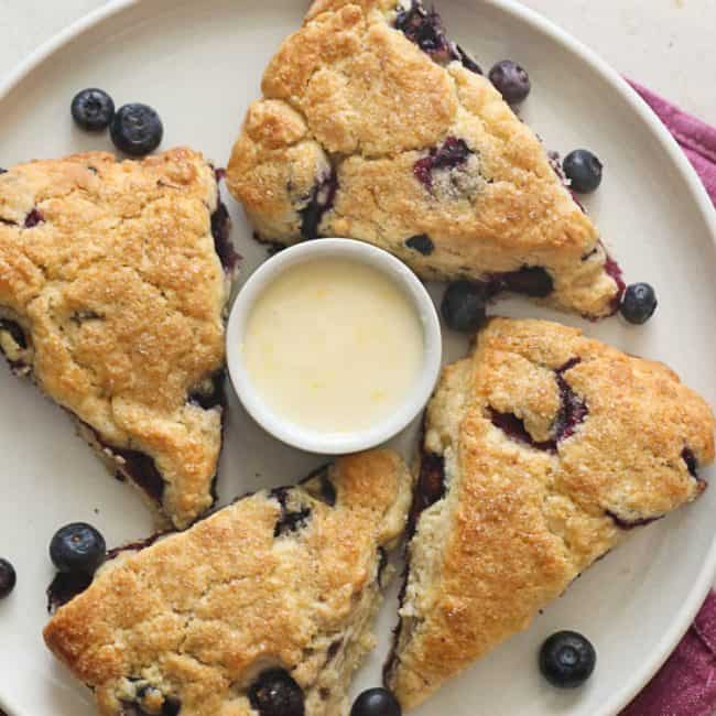 Lemon Blueberry Scones served on a plate with a dip