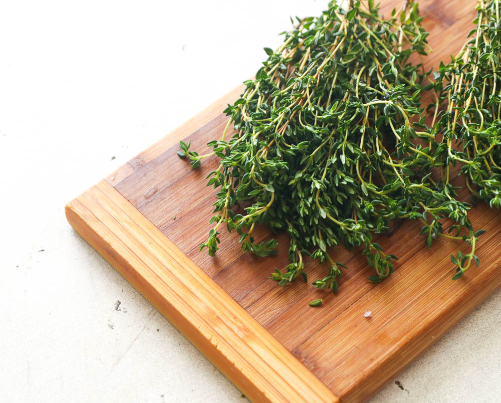 Sprig of Thyme on a wooden board