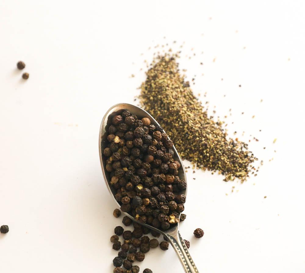 A heaping of black peppercorns