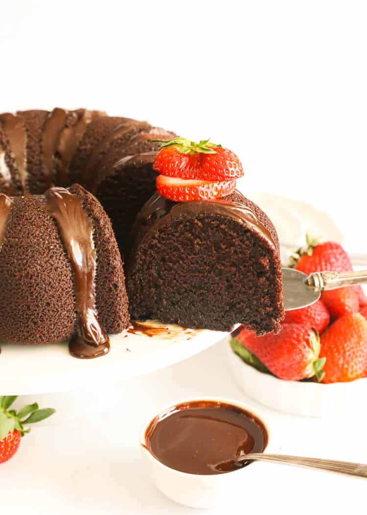 sliced whole chocolate pound cake with sliced strawberries