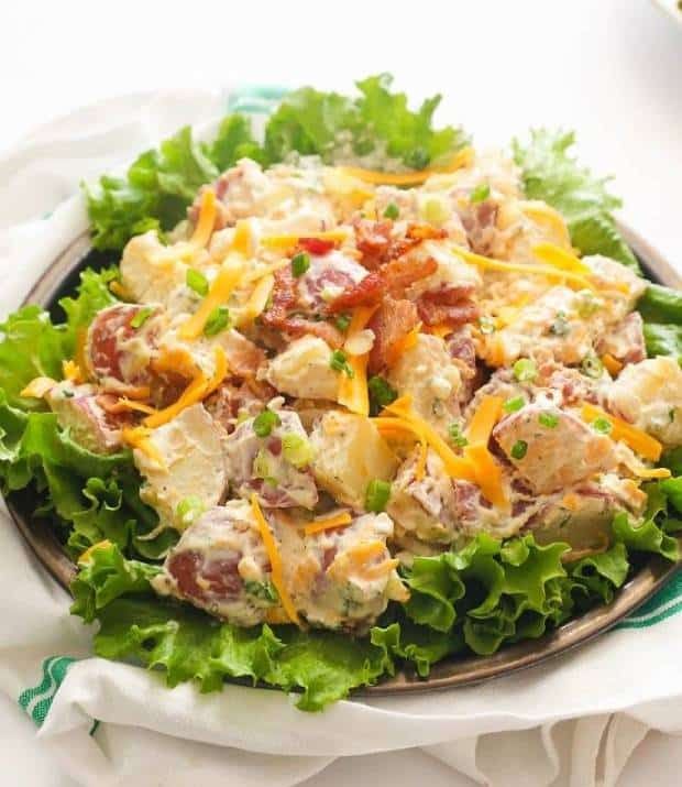 A bowl of Ranch Potato Salad served with lettuce