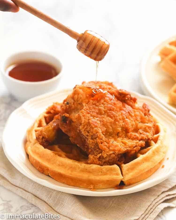 Chicken and Waffles drizzled with syrup