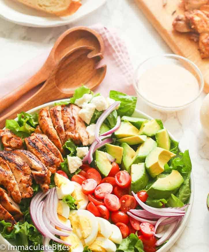 Cajun Chicken Avocado Salad with wooden spoon